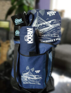 kxrw bundle with two shirts and two mugs in the tote bag