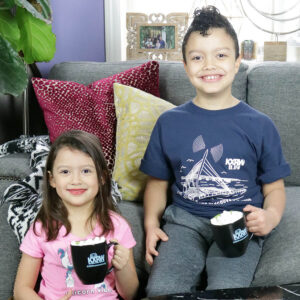 two kids holding KXRW mugs