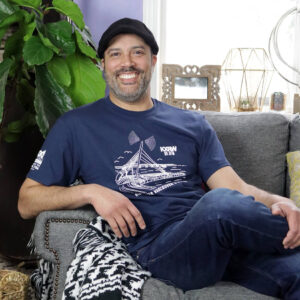 KXRW shirt with pier design on man sitting